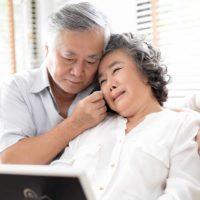 older couple in tears
